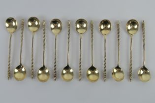 A set of twelve silver coffee spoons having barley twist handles and traditional Northern European