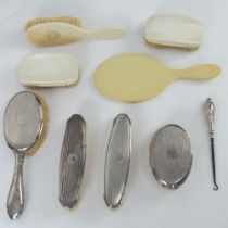 An HM silver dressing table set comprising hair brush and three clothes brushes.