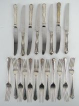 A set of HM silver dinner knives and forks for twelve settings by William Hutton & Sons Ltd,