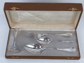 A German silver Christening set in original fitted box comprising fork, spoon, teaspoon and pusher,