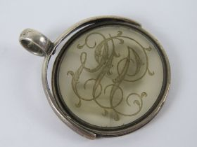 A Victorian double sided carved chalcedony spinning fob pendant seal having monogram with male