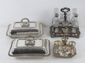 A graduated pair of silver plated lidded tureens,
