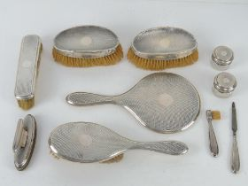An HM silver dressing table set comprising mirror, hairbrush, two rouge pots,