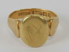 Freemasonry; An 18ct gold signet ring having square and compasses symbol upon,