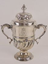 A large and impressive George III HM silver trophy cup having twin acanthus leaf scroll work
