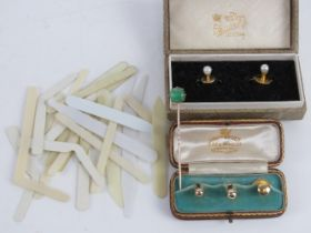 A matched pair of shirt studs, one marked 9ct, in fitted box,
