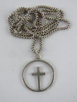 A silver crucifix pendant having cross within open hoop, stamped sil, on chain marked Sterling, 2.