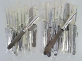 A set of twelve HM silver handled dinner knives,