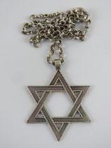 A large HM silver Star of David pendant on white metal chain, pendant 4.8cm inc bale, 17.3g.