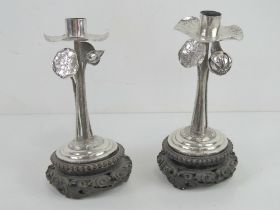 A pair of 19th century Chinese Qing Dynasty silver and wood Lotus flower candlesticks bearing marks