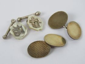 A pair of 9ct gold on silver cuff links together with a pair of Oriental white metal and mother of