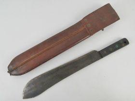 A WWII British machete with scabbard, marked J.J.