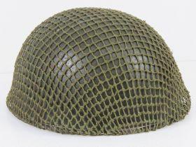 A British Paratrooper's helmet with liner and helmet net, dated 1983.