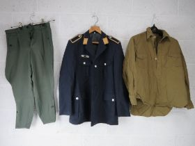 A post war Luftwaffe jacket size 42 together with a German WWII SS officers belt with strap.