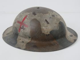 A WWI British Army Medics helmet, with liner and chin strap.