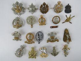 An assorted British regiment cap/helmet badges, approx 20 items, inc The Royal Scots, RAF,
