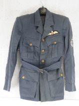 A WWII RAF Pilot Officer's No1 dress jacket having brass buttons and cloth badge upon,
