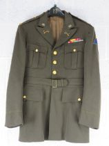 A US 7th armoured division Dress Jacket with insignia.