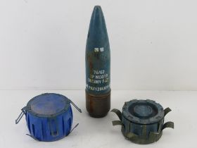 An inert British 76mm Malara Naval TP MOD79 cannon projectile with dummy fuse.
