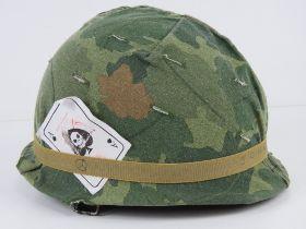 A US Vietnam war M1 helmet, Parish Division of the Dana Corporation Shell,