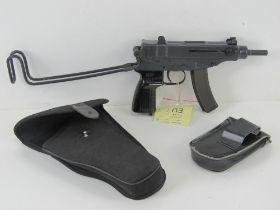 A deactivated Czech Skorpion Wz61 7.65mm Sub Machine Gun with black polymer grip.