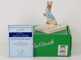 Royal Doulton Beswick Beatrix Potter; Peter on his Book, Limited until year 2002,