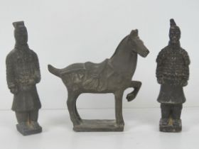 A pair of terracotta Chinese Warrior figurines, each standing 17cm high,