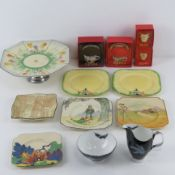 A 1930s crocus pattern hand painted cake stand by Royal Venton ware together with four assorted