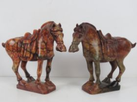 A fine opposing pair of carved marble Indo-Asian horse figurines each bearing saddle and bridle,