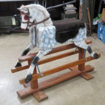 A vintage rocking horse having been naively refurbished.