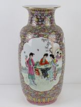 A large Chinese shoulder vase having female figures upon with pink and blue floral decoration and