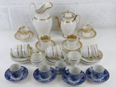 A set of four Noritake blue and white phoenix design coffee cans and saucers,