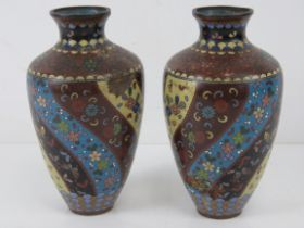 A pair of early 20thC cloisonné Canton enamel vases, a/f, each standing 19cm high.