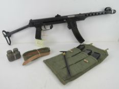 A deactivated PPS43 sub machine gun with 3x spare magazines , 1x magazine pouch, cleaning rod,