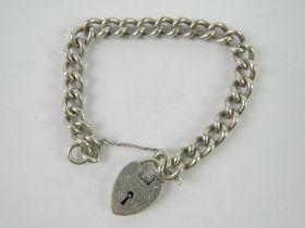 A heavy HM silver charm bracelet having