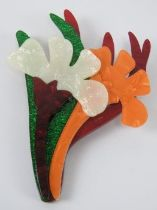 An overlaid plastic brooch in the style