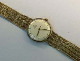 An Omega 9ct gold automatic wristwatch,