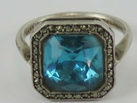 A silver, marcasite and blue stone cockt