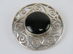A large Celtic style silver and onyx pla