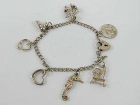 An HM silver charm bracelet having part