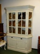 A WHITE PAINTED COUNTRY STYLE DISPLAY CABINET WITH TWO DRAWERS OVER TWO DOORS BELOW 164cm WIDE x 22c