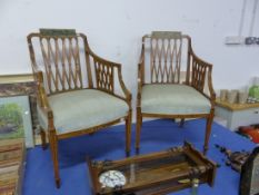 A PAIR OF NEOCLASSICAL STYLE PAINTED SATINWOOD ARMCHAIRS, THE TOP RAILS PAINTED WITH VILLAGE