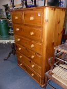 A TALL PINE CHEST OF DRAWERS.