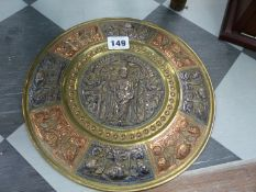 AN EASTERN REPOUSSE DECORATED BRASS SILVER AND COPPER PLATE.