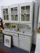 A PAINTED PINE GLAZED TOP DRESSER.
