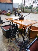 A CAST IRON BASED GARDEN TABLE AND A WROUGHT IRON LANTERN MOUNT