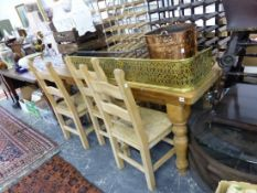 A LARGE PINE KITCHEN TABLE TOGETHER WITH A SET OF SIX RUSH SEAT LADDER BACK CHAIRS.