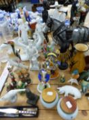 A COLLECTION OF FIGURINES TO INCLUDE LLADRO NUNS, KAISER FIGURINE, A RUSSIAN PAINTED SOLDIER, GOEBEL