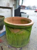 TWO LARGE ROUND TERRACOTTA PLANTERS.