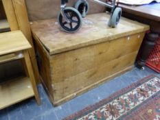 A LARGE ANTIQUE PINE BLANKET BOX.